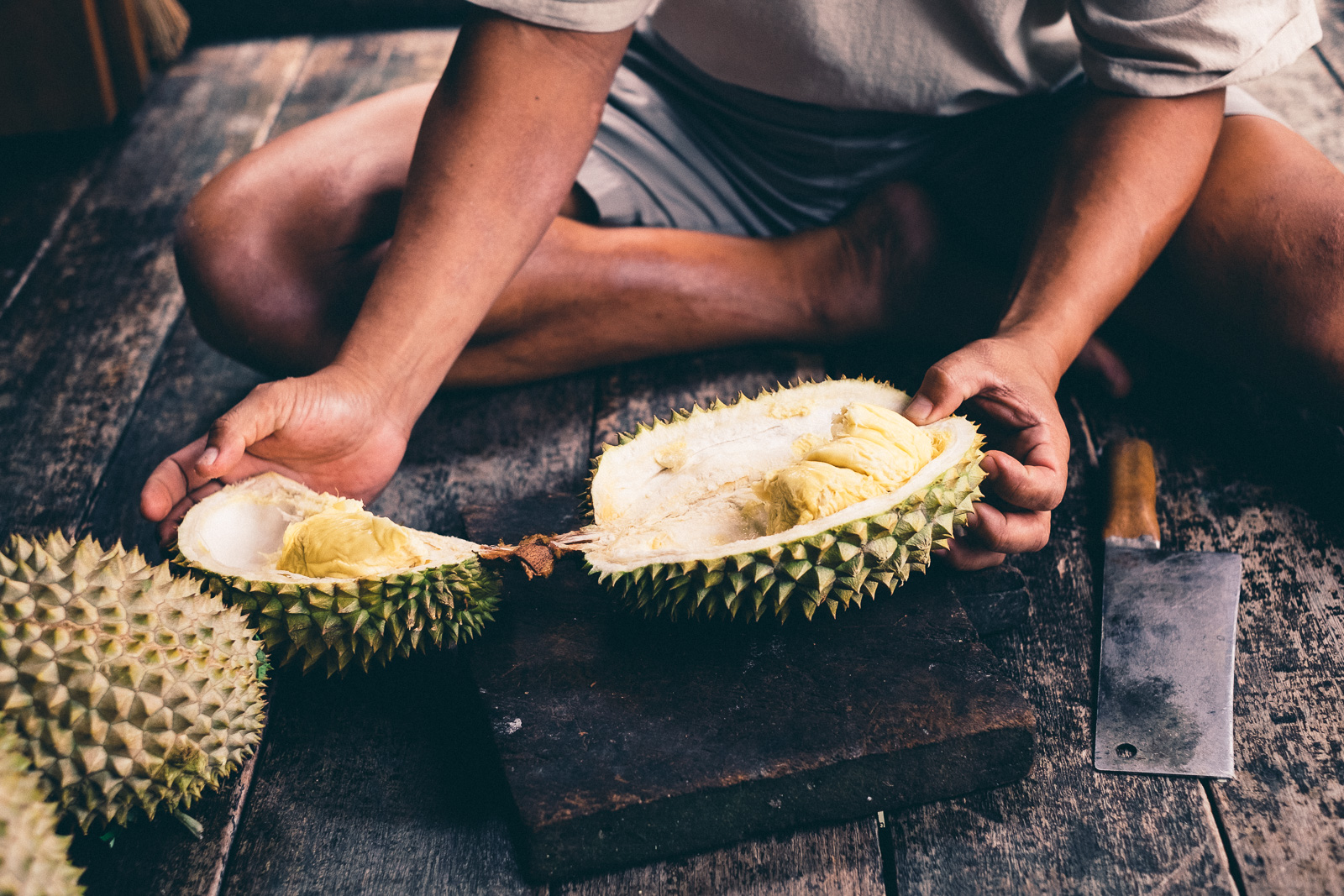 Opening the durian - Penang Editorial Photographer